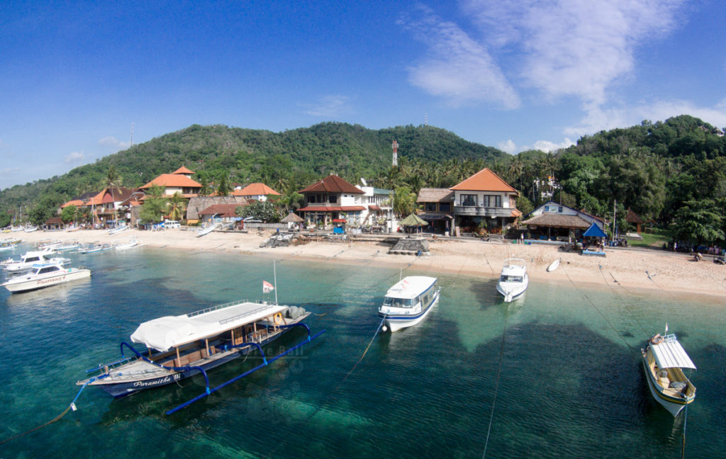 aerial drone photography bali padang bai village with harbour beach with geko dive speedboats